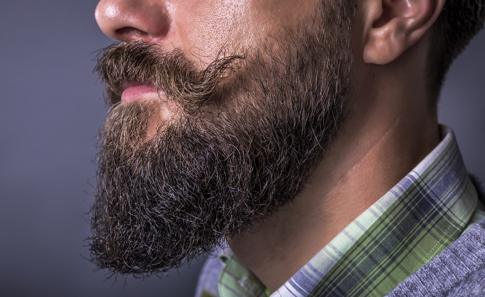 perdita peli barba a chiazze